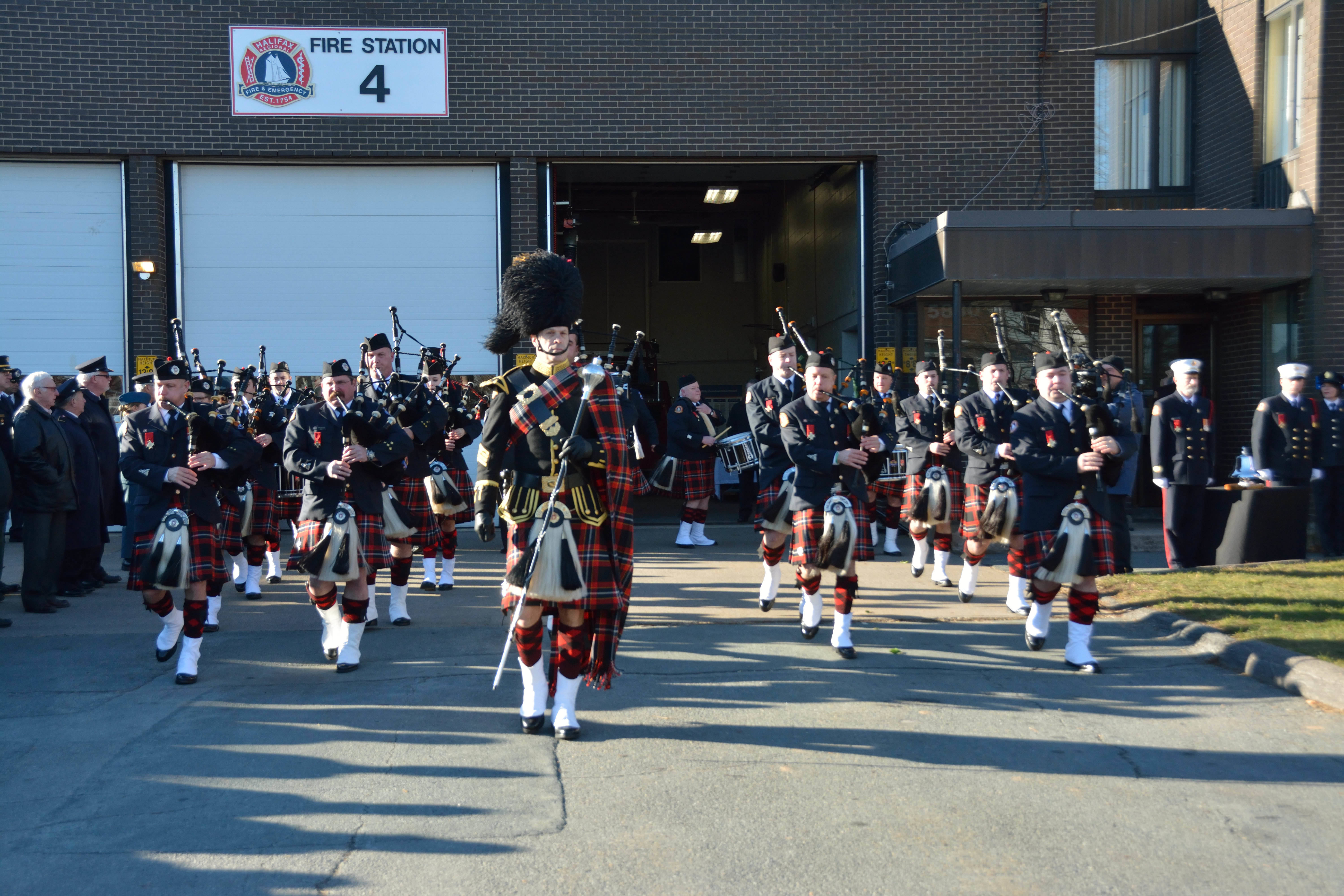 A photo of the Union Fire Club Pipes and Drums playing at the 2016 Halifax Explosion Memorial service at Station 4.