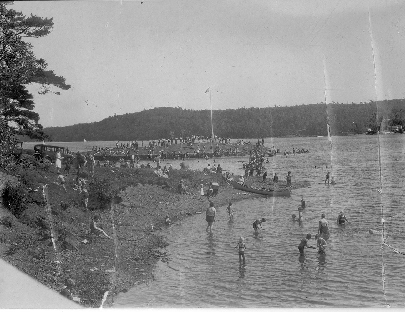 Black and white image of Bathers enjoy the waters of Northwest Arm at Horseshoe Island on Regatta Day, 1912 [102-106-1-7 (cropped from original)]