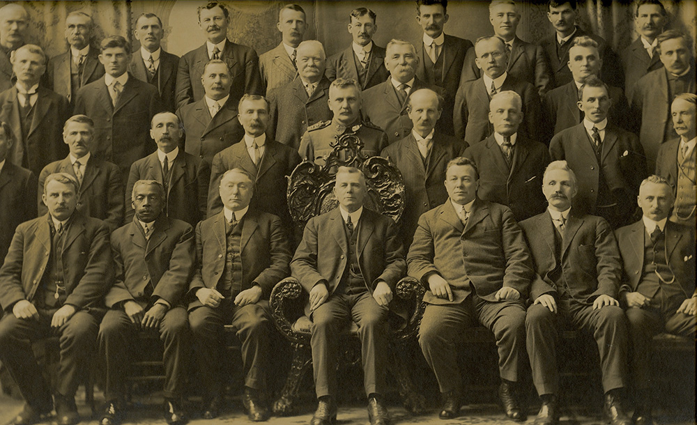 Black and white group photo of County councillors