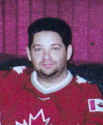 Bruce Andrew Forbe picture in red hockey jersey