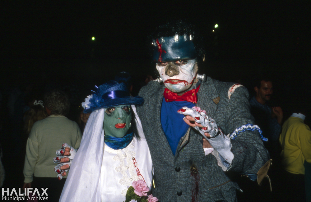 Colour photo of two masked ghouls.