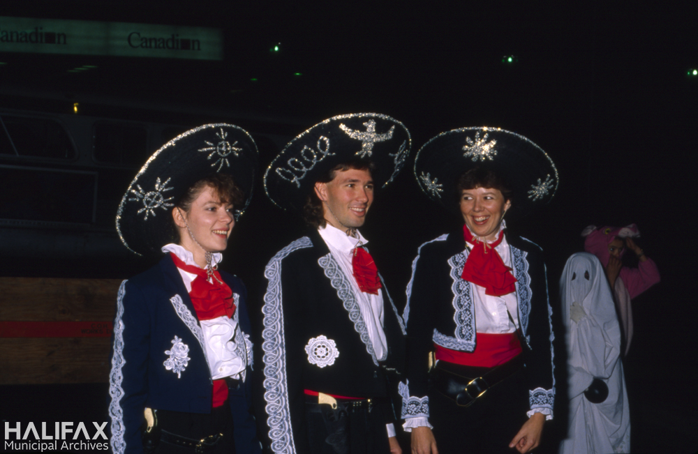 Colour photo of three participants dressed in Mexican mariachi costumes