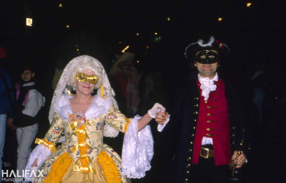 Colour photo of costumed couple.