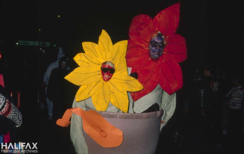 Colour photo of two participants in a flower pot costume