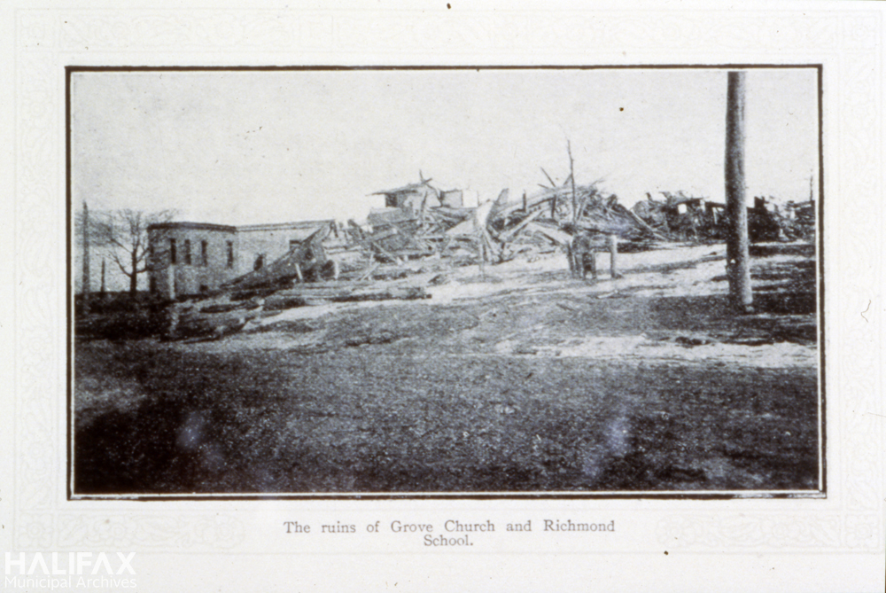 Black and white photograph of ruined church and school.
