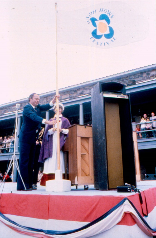 Colour photograph of a ceremonial flag raising event