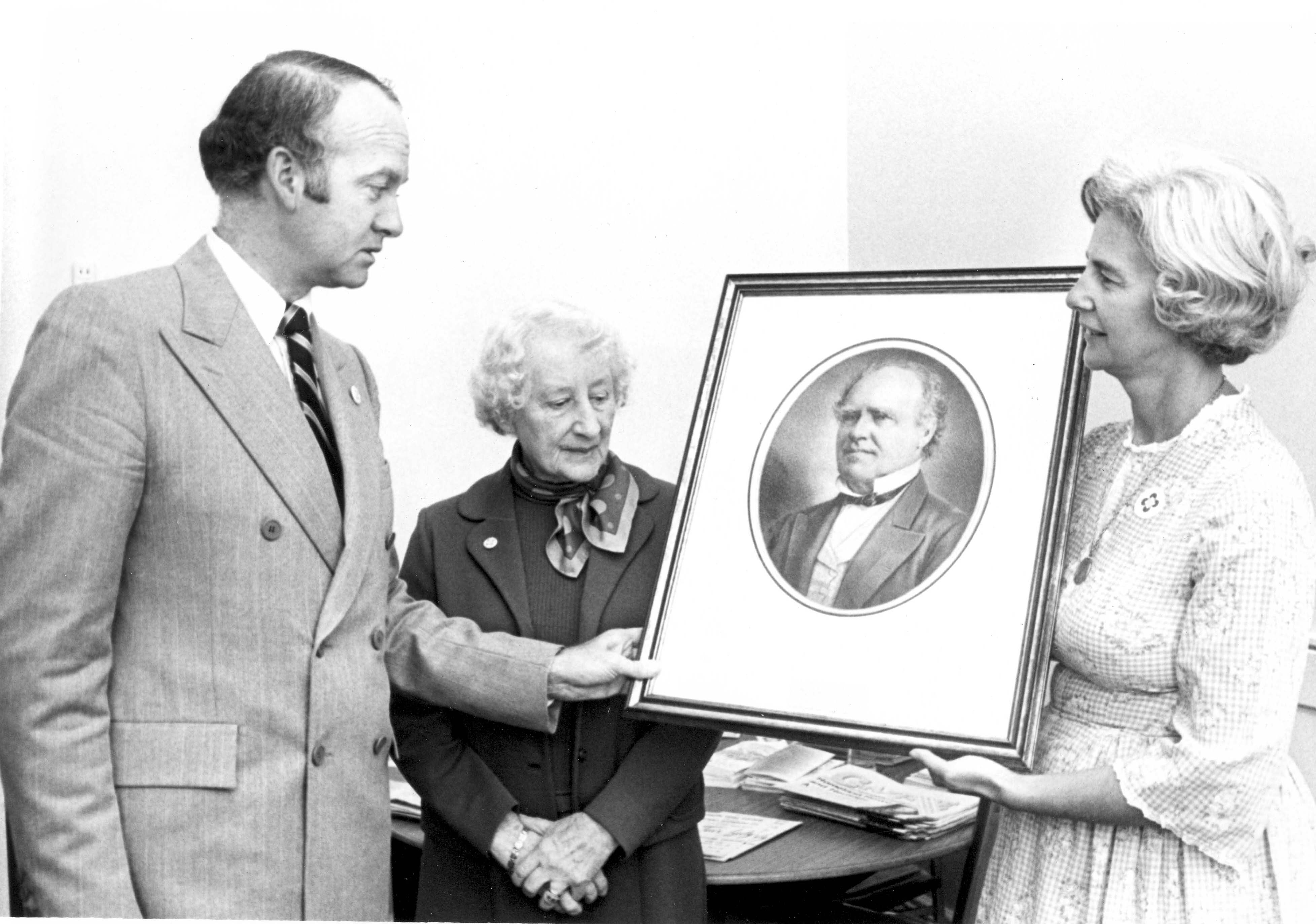 Black & white photo of an event for the ceremonial presentation of a portrait