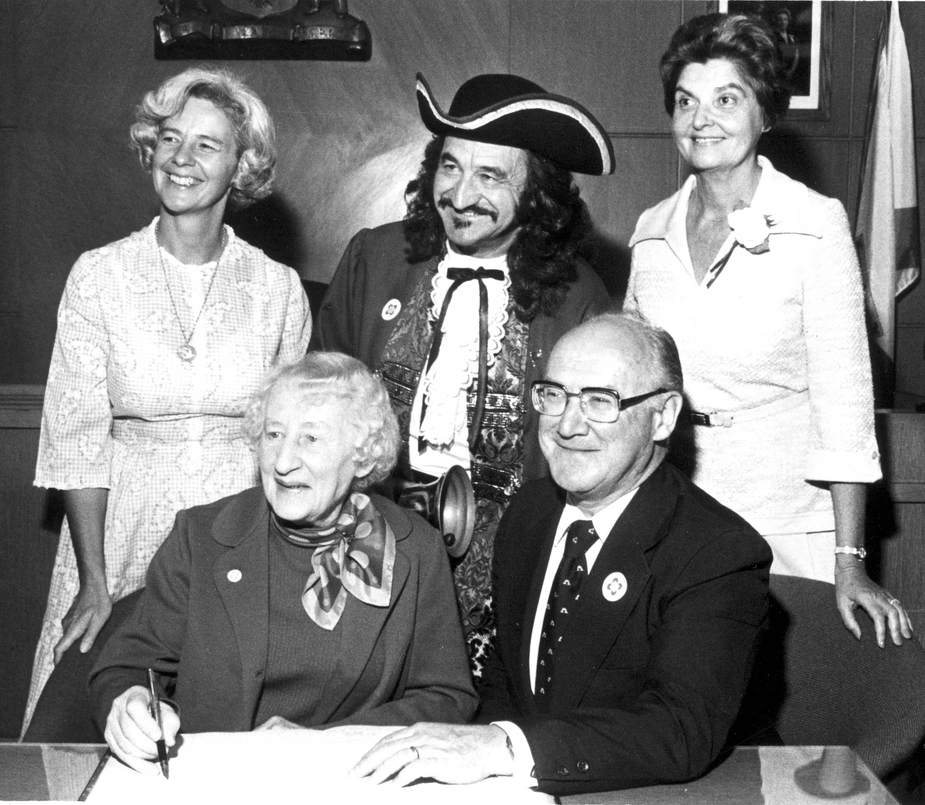Black & white photo of a signing ceremony