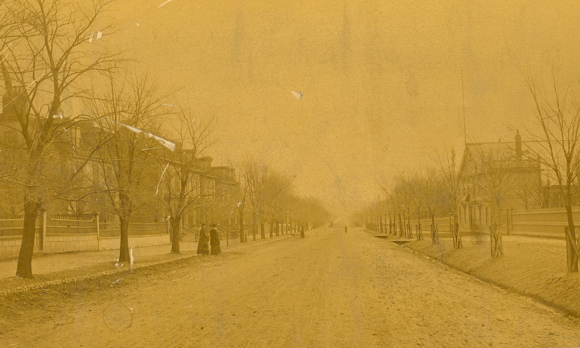 Sepia photo of a wide street in winter.