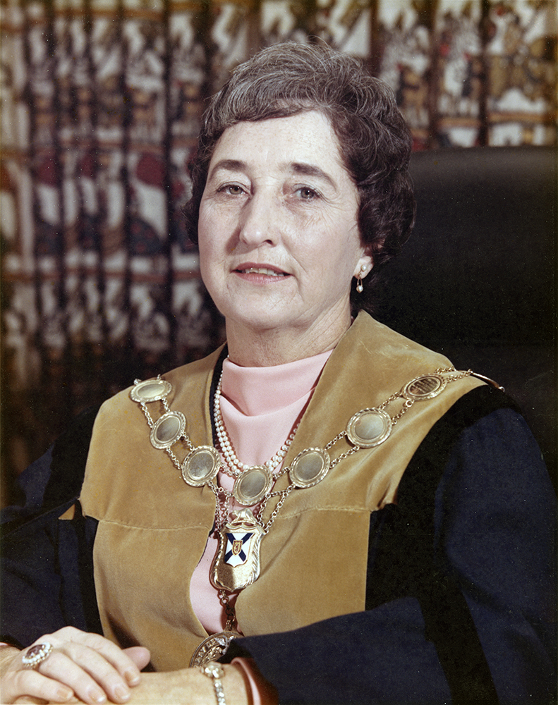 Colour photograph of a woman wearing the robes and chain of office for the City of Dartmouth