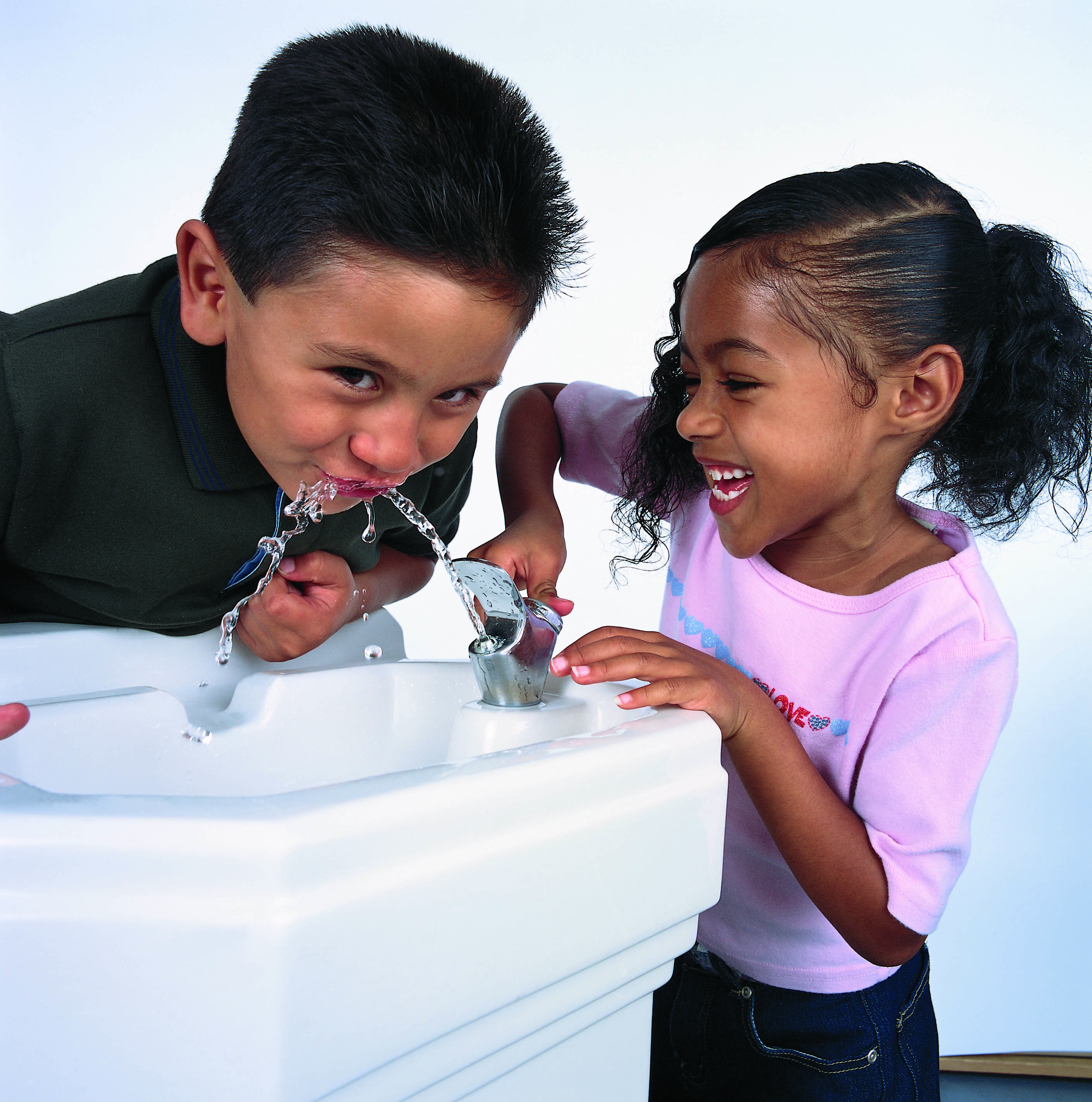 Children drinking clean water from a fountain