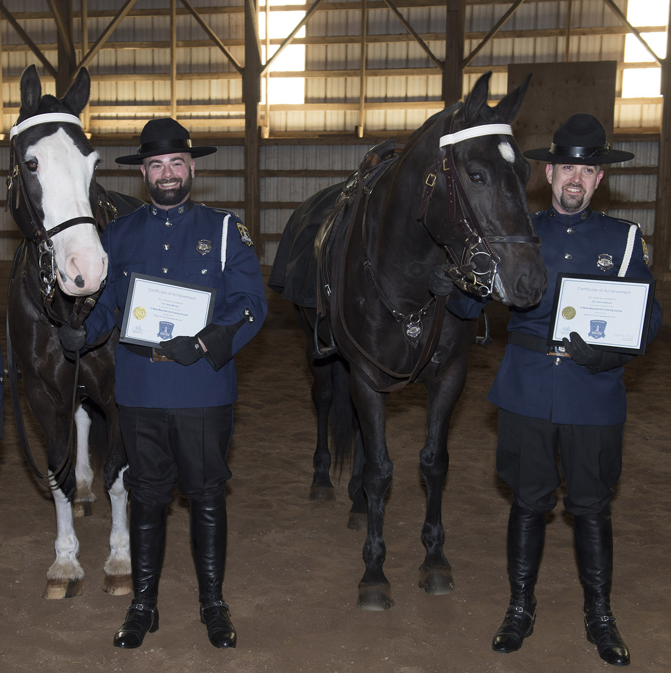 Photo of police horse, Duty Sergeant, with partner, Constable Ryan Morash and police horse, Valour, with partner, Constable David Gallivan