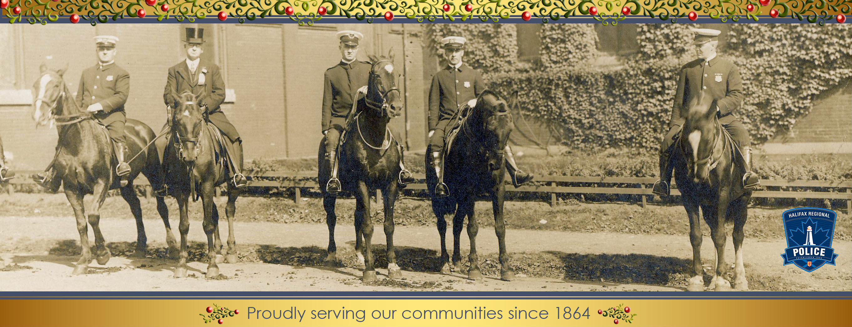 Photo of the HPD Mounted Squad in 1902 accented with holiday garland.