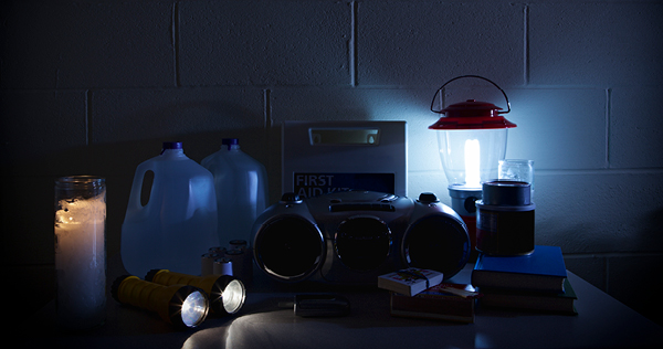 Close up image of a room dimly lit by battery operated lights during a power outage.
