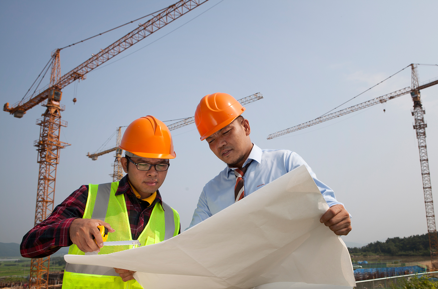 A photo of two men at a construction site