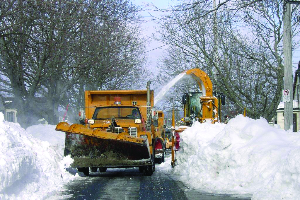 A photo of a snowplow clearing a street