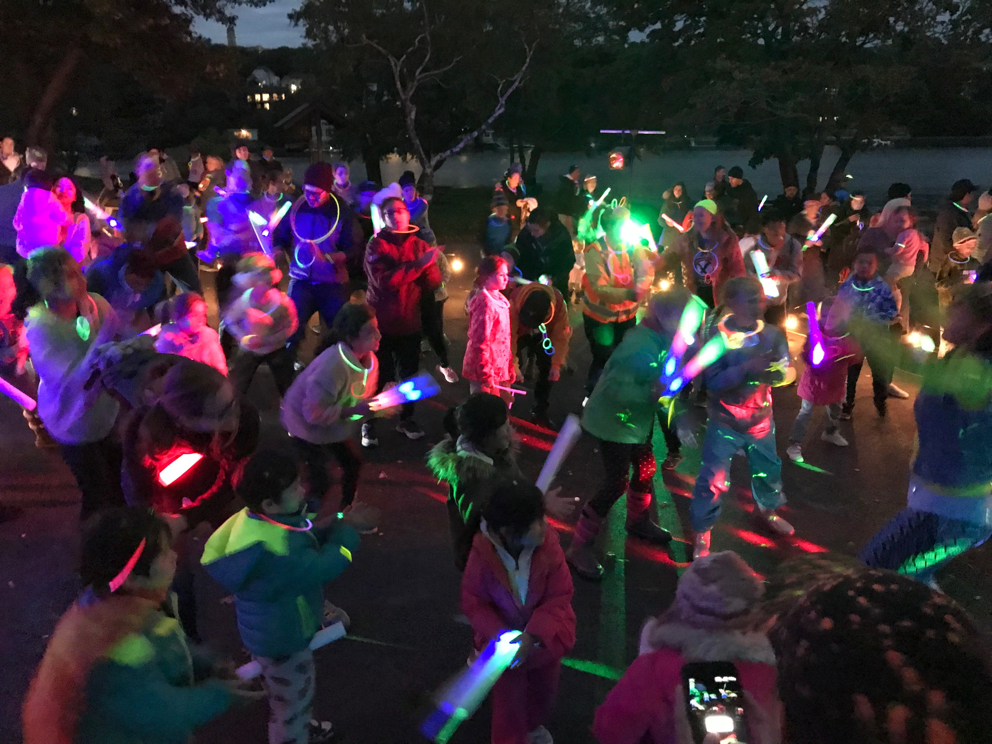crowd dancing at Glow in the Park event