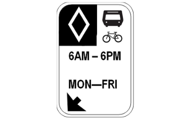 a white diamond on a black background, a bus icon and a bike icon. 6AM-6PM, MON-FRI. This sign indicated that this is a bus lane during the specified hours.