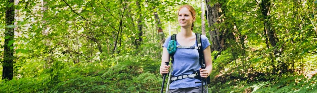 a women hikes in the woods