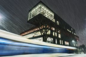 a long-exposure of a Halifax Transit bus driving past the Halifax Central Library