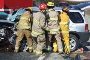 Volunteer firefighters responding to the scene of an accident.