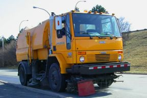 Yellow street cleaning vehicle