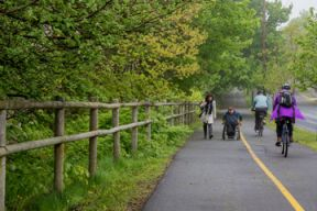 Residents enjoying the Halifax Urban Greenway on an overcast day.