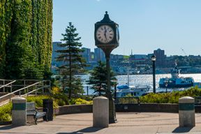 A photo of the town clock and surrounding park area at Alderney Landing in Dartmouth