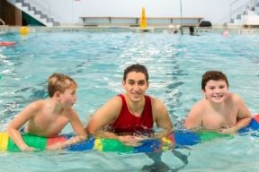 lifeguard in the pool with two children