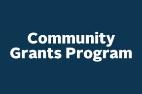 "Graphic of blue square with white text that reads ""Community Grants Program"""