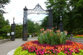 The Halifax Public Garden gates with a bright flower bed in the foreground