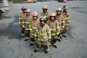 Firefighters standing in a V formation