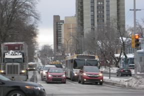 Buses at a traffic light on Robie