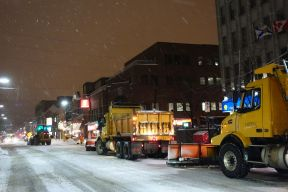 plowing downtown street at night