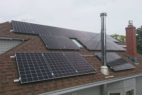 Multiple solar panels on a house roof