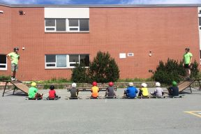 children sit beside skateboards at recreation facility in Sackville