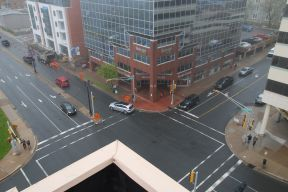 a bird's eye view of the Ochterloney Street and Alderney Drive intersection on a cloudy day