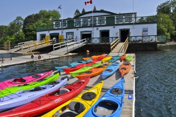 kayaks sit beside the boat launch at St. Mary's Boat Club