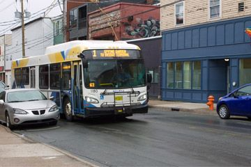 The 1 Spring Garden bus drives past parked cars on Gottingen Street