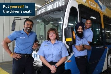 A group of smiling Halifax Transit Operators.